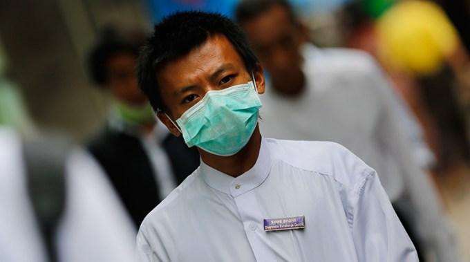 Myanmar calls for calm after three die of swine flu
