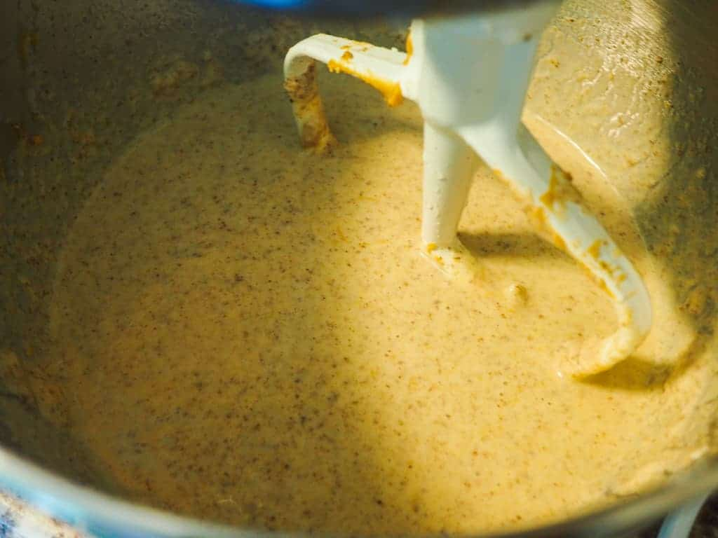 A mixing bowl with mashed banana, flax, peanut butter, and yogurt.