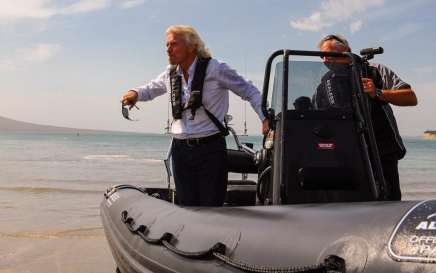 Richard Branson test drives an amphibious Sealegs boat in Waitemata Harbour off Takapuna Beach, on October 21, 2011 in Auckland, New Zealand.