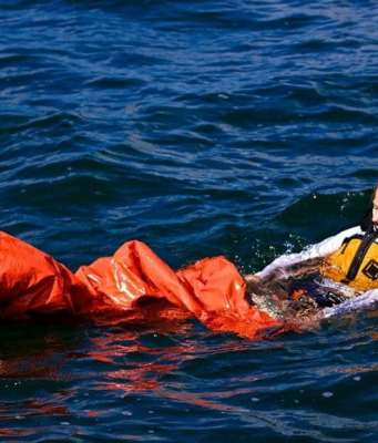 An image of a woman using the Land Shark Survival Bag