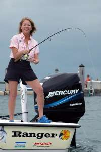 """Betty Bauman, founder and CEO of """"Ladies Let's Go Fishing!"""" doing what she teaches."""