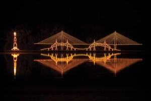 Festive lights illuminate a Charleston bridge. Photo credit: Bluewater Movements