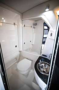 The interior cabin contains a full-sized head with shower. Photo: JLambertPhotos.com