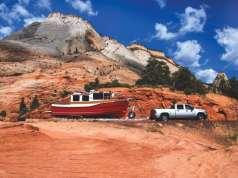 Snowboaters take their Ranger Tug through the Mountains