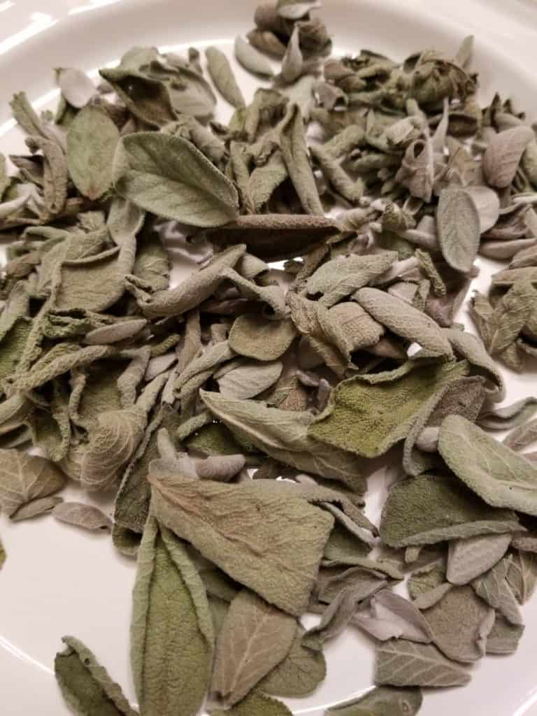 Easiest Way to Dry Herbs, White plate full of Dried Sage leaves