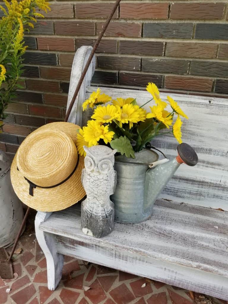Update Past Front Porch Fall Decor, Fall Decor, Straw Hat on bench with watering can full of yellow flowers and owl sitting beside