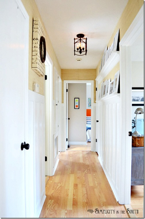 Board-and-batten-hallway-with-gallery-shelves.