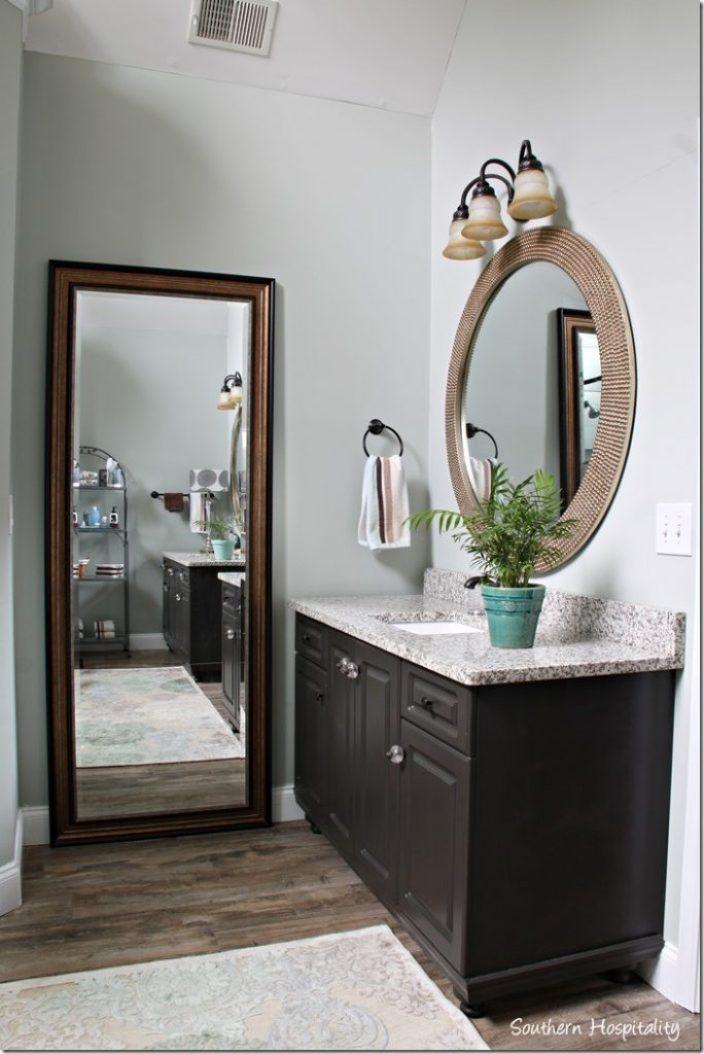 left vanity with floor mirror
