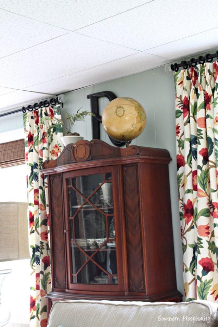 china cabinet and drapes