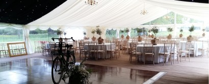 The large clear gable end and panoramic windows allow the beautiful grounds of this wedding venue at West Dean College to be enjoyed from inside the marquee.