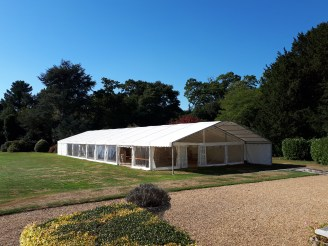 Large multi span marquee with clear gable end and panoramic windows.
