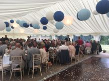 Wedding in full swing with blue paper lanterns interspersed with our white paper lanterns.