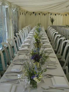 We provide the marquee and you can dress it in whatever style you like! Trestle tables gave this party a summer picnic theme.