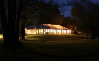 This pretty wedding marquee at Timsbury Manor looks stunning with the lights within giving off a welcome glow....