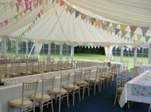 A trestle table layout looks so fresh and pretty in this traditional style marquee.