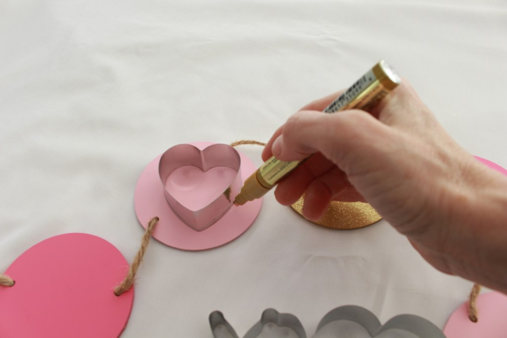 Hand tracing heart on Valentine's Day Garland