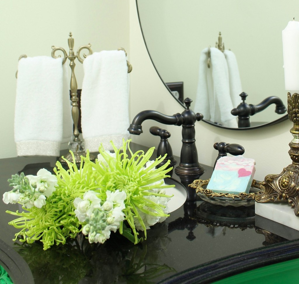 Fresh flowers for a small bathroom makeover with lacquered furniture and vintage southern vibes. Colorful room.