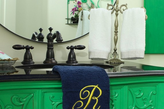 Lacquered Green Bathroom Vanity and Vintage Light Fixture make a colorful Chinoiserie Style Powder Room