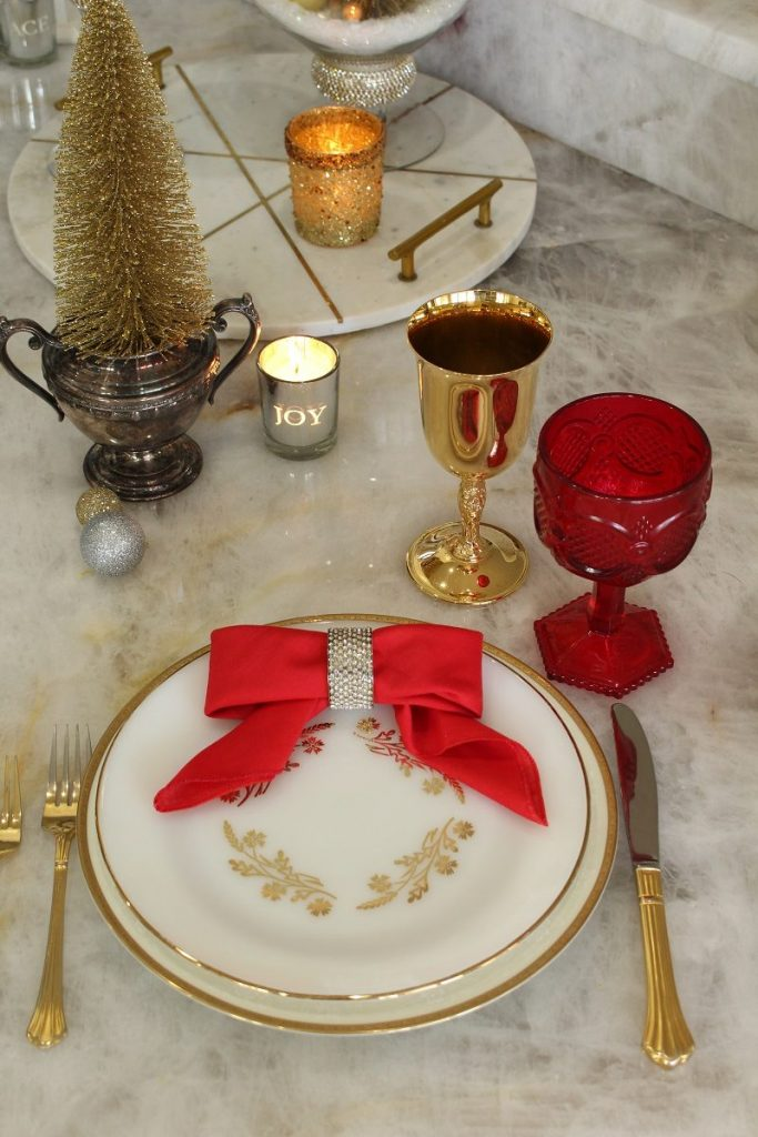 Christmas Table Setting with Red Napkin folded as bow