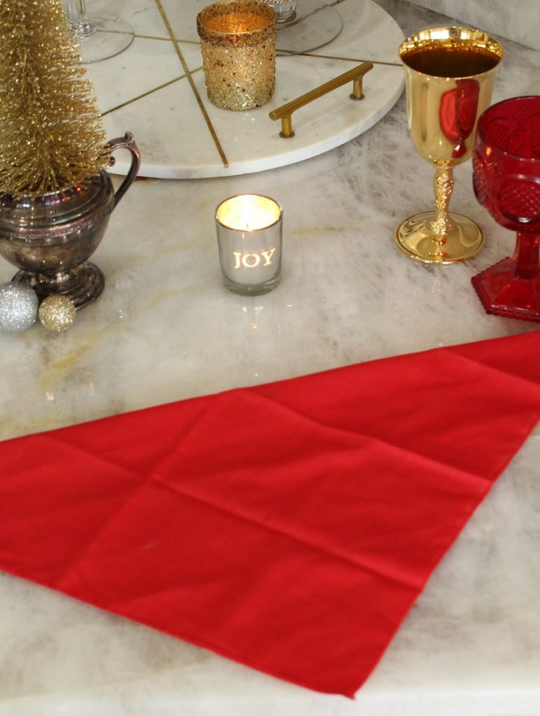 Red Napkin folded on Christmas Table Setting