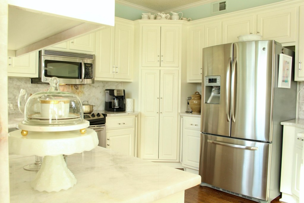 White Kitchen Cabinets with Stainless Steel Refridgerator