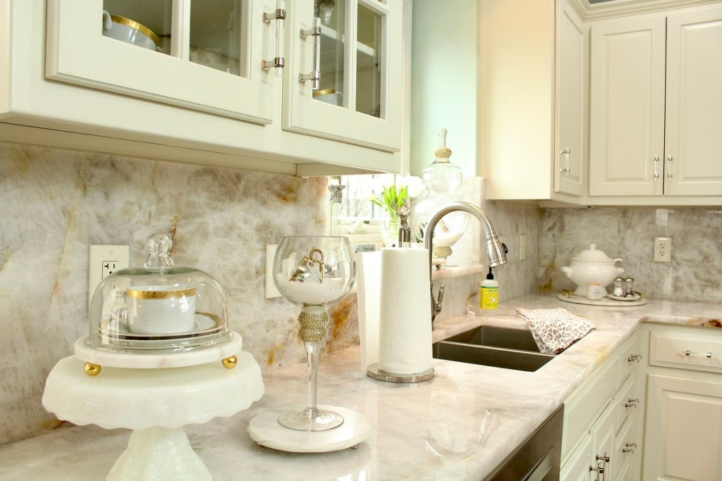 White Cabinets and Countertops with brushed gold cup and saucer