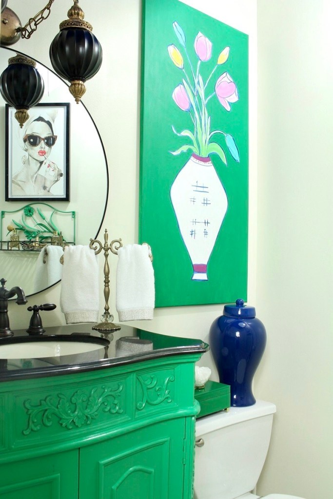Colorful Bathroom with Green Cabinet and Blue Ginger Jar