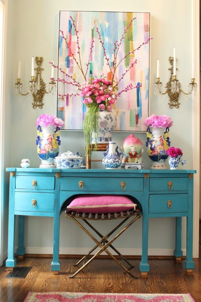 Colorful Entry with Turquoise Desk and Faux Flowers