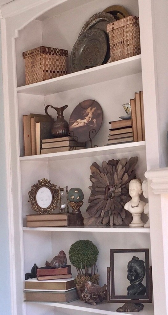 French Decor Items Sytled in a Bookcase