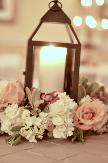 Lantern with flowers centerpieces — southern productions