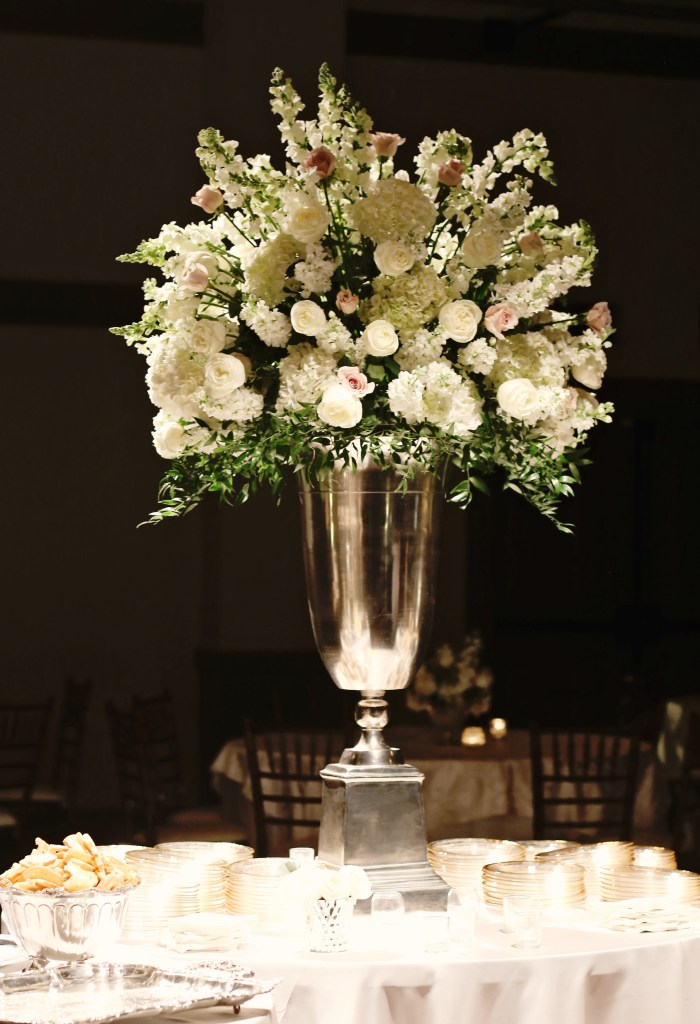 blush roses, white roses, hydrangea and snapdragon centerpiece | silver urn arrangement, large food buffet arrangement | meridian ms wedding flowers | southern productions | ivory and blush centerpiece for food buffet