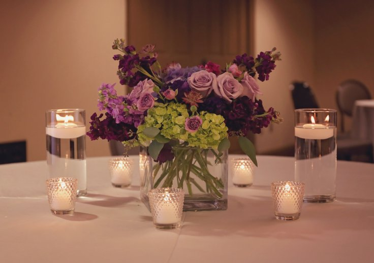 purple centerpiece by meridian ms florist southern productions