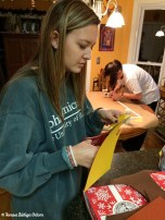 Emily cuts out leaves from construction paper