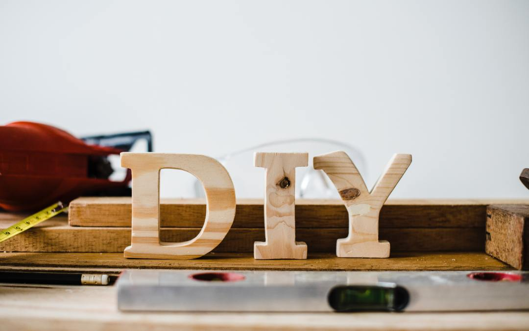 wooden letters standing on table spelling DIY