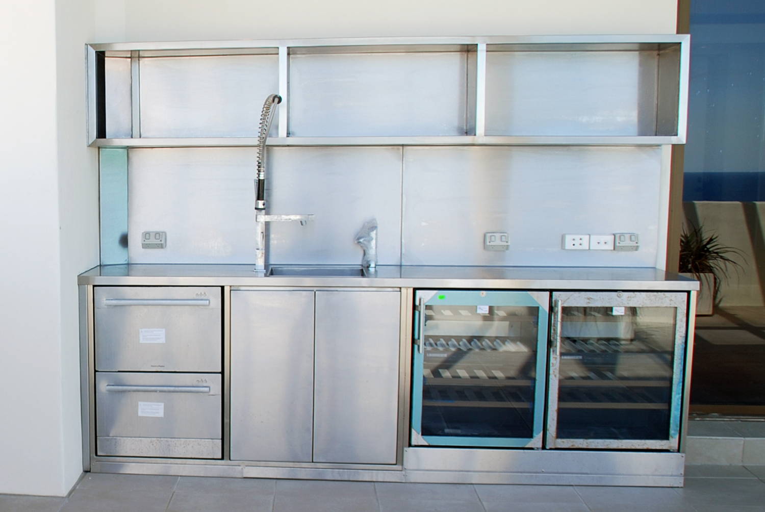 Residential stainless outdoor kitchens and benches