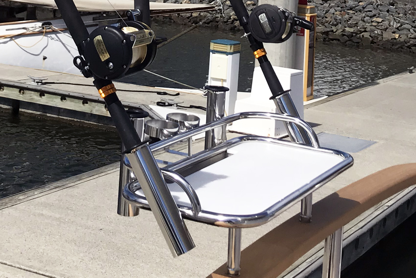 Stainless tubular bait board with rod holders