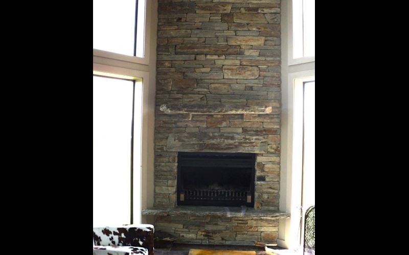 Traditional Schist Chimney In Tight Stack With Large