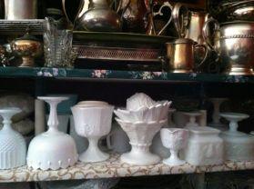 Shelves of milk glass & silver