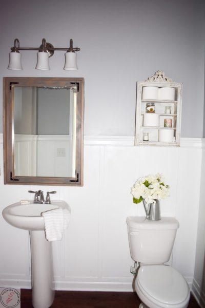 1/2 Bathroom Board and Batten completed bathroom board and batten, grey/gray walls, wood mirror frame, sink, toilet, silver light fixture