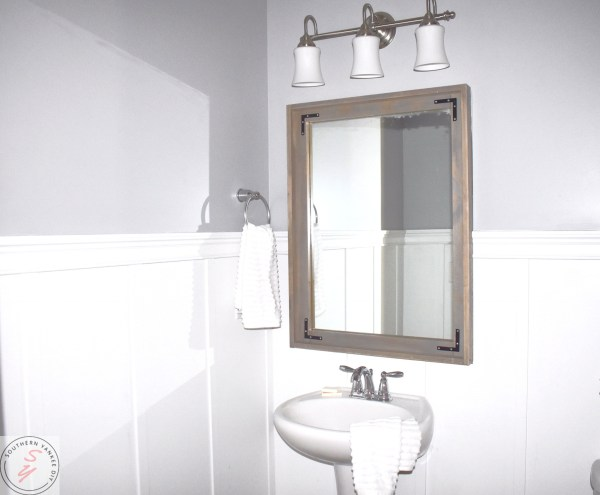 1/2 Bathroom Board and Batten completed board and batten, gray walls, wood framed mirror, half bathroom, white towles