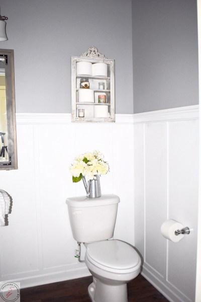 1/2 Bathroom Board and Batten bathroom board and batten complete, gray walls, antique white shelf, white flower