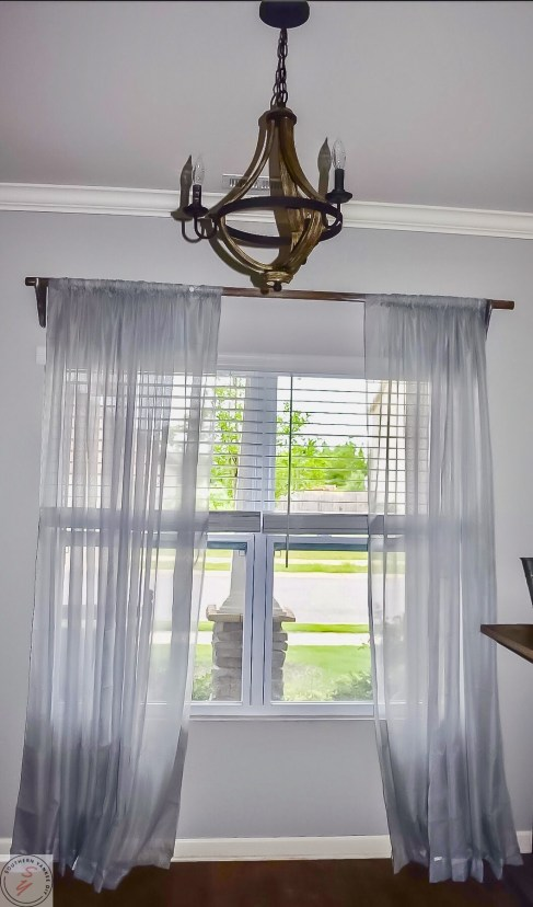 gray curtains, wood chandelier, diy curtain rods and brackets
