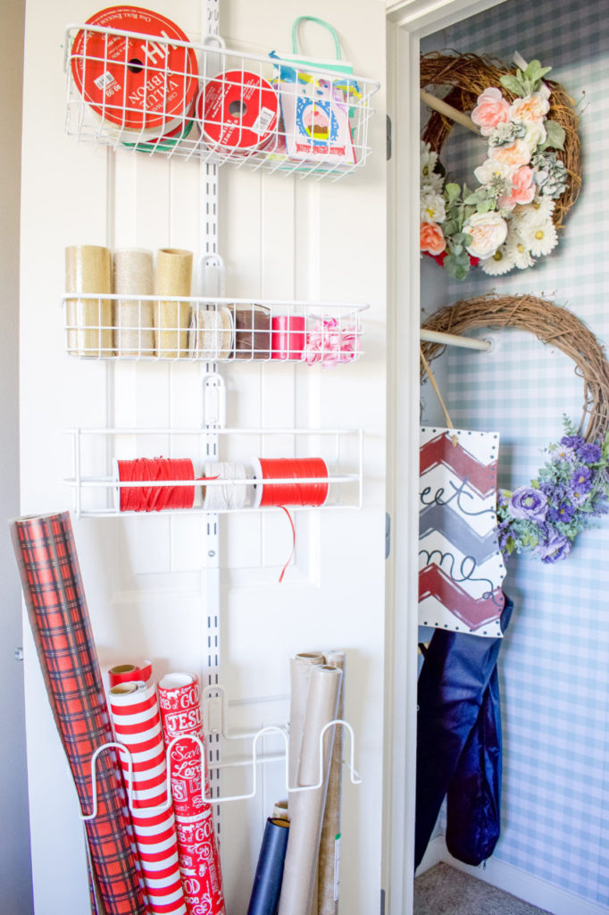 before/after, craft closet, closet organization, office closet, organized living, wrapping paper storage, gift wrap storage, shelving, closet shelving, diy closet shelving, wreath storage, faux wallpaper, contact paper feature wall, wallpaper, closet storage