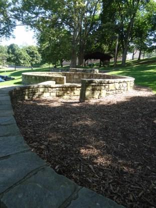 stone wall, mulch path to pavilion