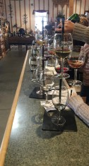 A sommelier at Heritage Vineyard in Mullica Hill, N.J., prepares the wine flights by pouring wine in each glass.