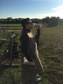 """Nick Morello, 21, an Advertising major at Rowan University, enjoyed the beautiful scenery at Heritage Vineyard in Mullica Hill, N.J., Wednesday October 26, 2016. Morello posted up against the fence to watch the sunset while enjoying a glass of wine. (Photo/Amanda Dean) """"This is the perfect way to end the day. Life is always better when having a glass or wine in your hand"""" said Morello."""