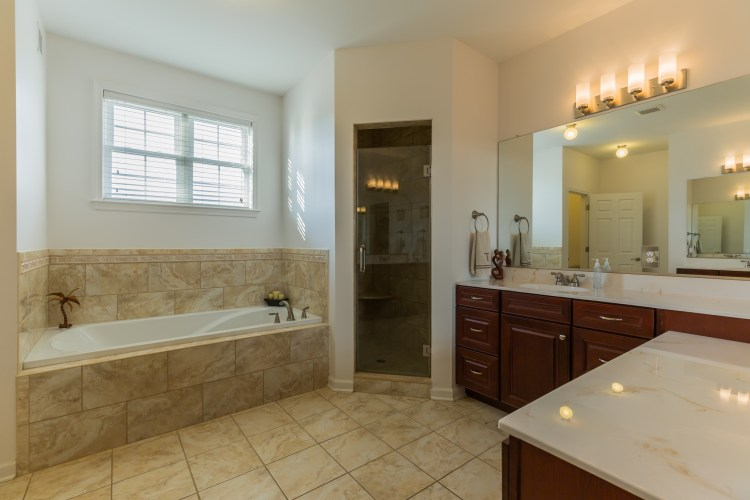 The Master Bathroom has two vanities and soaking tub