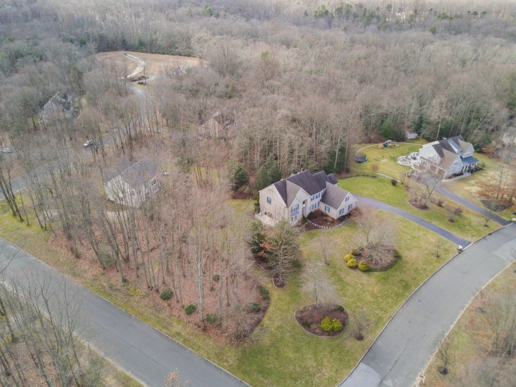 Aerial View showing the large corner lot and surrounding trees that give this home much coveted privacy.