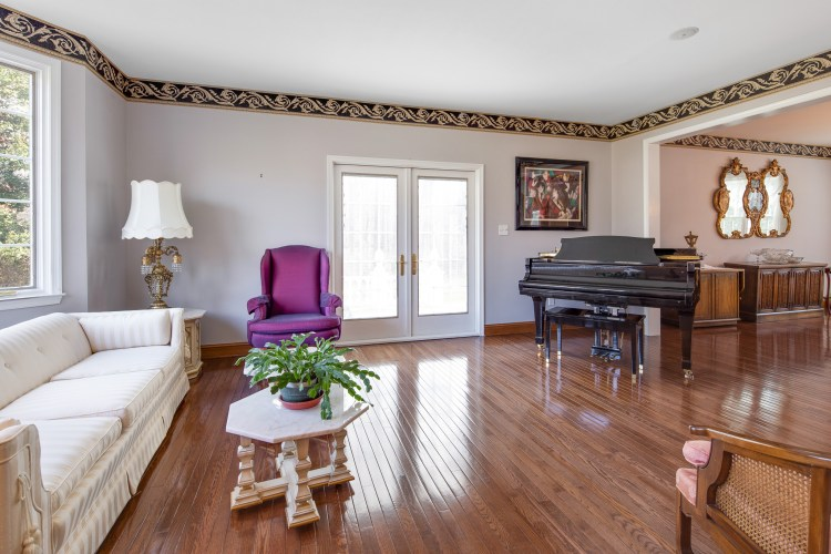 The Formal Living Room with French Doors to the Patio