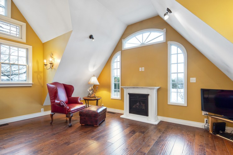The living room with Gas Fireplace and mantle